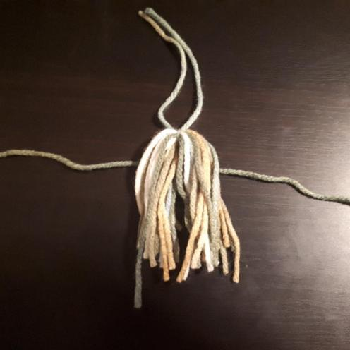 Tassle add decorative strap