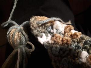 Thread tassel into textured scarf corner