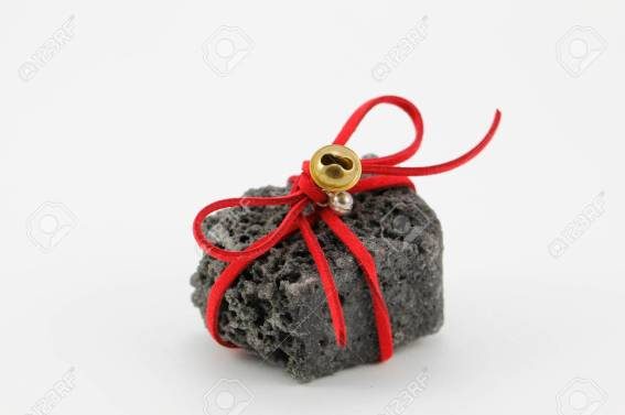 Christmas coal with red ribbon, sweet gift for naughty boys